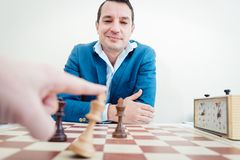 Man setting woman checkmate. She is accepting defeat royalty free stock images