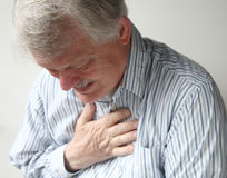 Man with severe chest pain stock photo