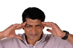 Man with severe headache holding his head royalty free stock photo