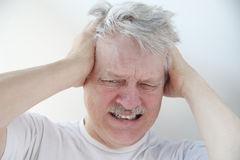 Man with severe headache pain Royalty Free Stock Image