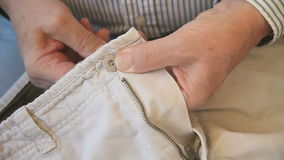 Man sewing button stock video