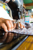 Man with a sewing machine Stock Photos