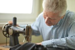 Man at sewing machine Stock Image