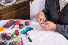 Man sewing traditional sport balls. Expert male hands sewing pelota balls, traditional Mediterranean sports equipment Stock Images
