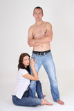 Man and sexy girl sitting Royalty Free Stock Image
