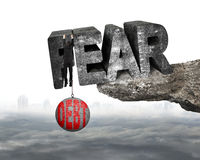 Man shackled debt ball hanging fear word edge cliff cloudscape Stock Image