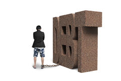 Man shackled by DEBT Stock Photo