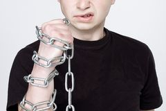Man and shackles. The concept of freedom, hatred, revenge.  stock photography