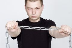 Man and shackles. The concept of freedom and slavery.  stock image
