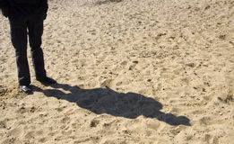 Man shadow. A shadow of a man on the sand royalty free stock images