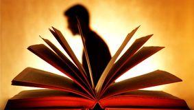 Man Shadow behind of Open Book royalty free stock image