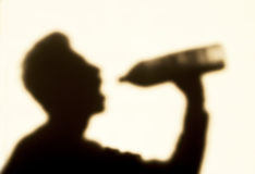 Man in shadow, drink a water. Man in shadow drink a water Royalty Free Stock Photography