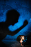 Man shadow hitting naked woman. Rape or domestic violence victim concept. Royalty Free Stock Images