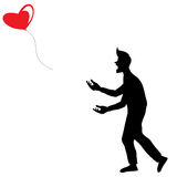 A Man In Shadow Let the Red Balloon Shaped Heart Fly Away. Isolated On White Background Stock Photography