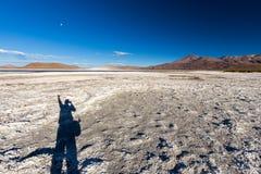 Man shadow selfie  pink flamingo birds flock lake, Bolivia. Royalty Free Stock Image