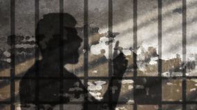 Man Shadow Talking Under Jail Bars. Freedom of Speech Metaphor. Comic Cloud on Concrete Wall royalty free stock photography