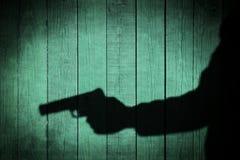 Man in the Shadows with handgun, XXXL Royalty Free Stock Photos