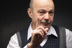 Man shakes his finger, barring something. Elderly man threatens with a finger. Shaking his finger, angry at work Stock Photography