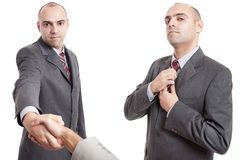 Man shaking hand and straighten his tie Royalty Free Stock Photos
