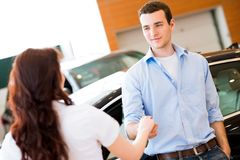 Man shaking hands with car salesman Royalty Free Stock Photos