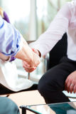 Man shaking hands with manager at job interview closeup cutout. Employment candidate hiring resume CEO work business Royalty Free Stock Photos