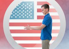Man shaking his hand against american flag Stock Photography