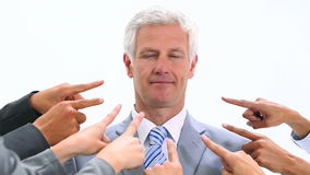 Man shaking his head while fingers are pointed at him stock footage