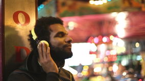 Man shaking his head to the rhythm of music with headphones stock footage