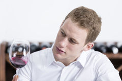 Man shaking a red glass of wine Royalty Free Stock Photo