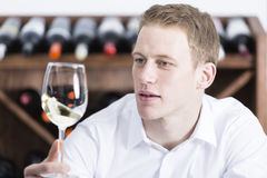 Man shaking a white wineglass Stock Image