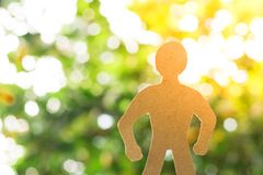 Man shape paper on tree blurry background in garden . using wallpaper or background for education, business photo. Take note of th royalty free illustration