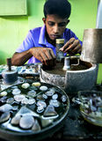 A man shapes a piece of moonstone at a factory in Mitiyagoda on the west coast of Sri Lanka. Stock Photo