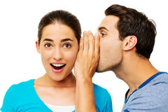 Man Sharing Secret With Surprised Woman Royalty Free Stock Photo