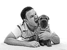 Man with sharpei puppy black and white. Young caucasian man with scary face triing to bite a sharpei puppy  on white  background, black and white Stock Photos