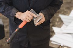 A man sharpens a pencil with an ax royalty free stock photography