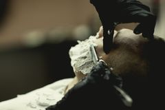 Man shave a straight razor. close up with hands royalty free stock images