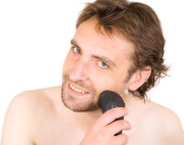 Man with shaver Stock Images