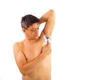 A man shaves armpit hair. Cutout royalty free stock photography