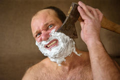 Man shaves with an ax Stock Photos