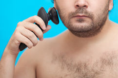The man shaves a cheek Stock Photography