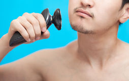 The man shaves a cheek Royalty Free Stock Photo