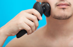 The man shaves a cheek Stock Images
