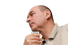 Man Shaves His chin. A mature man shaves his chin, isilated on white stock images