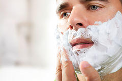 Man shaves his face Royalty Free Stock Photography