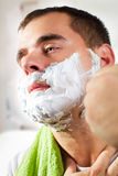 Man shaves his face Royalty Free Stock Photo