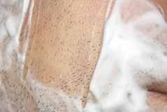 A man shaves the machine. Background shave with shaving cream stock photography