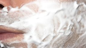 A man shaves the machine. Background shave with shaving cream royalty free stock photo