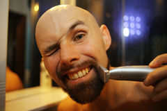 Man shaves trimmer Royalty Free Stock Image