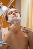 Man shaving Stock Photography