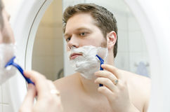 Man shaving. Stock Photos